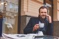 Relaxed businessman making coffee break