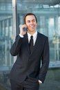 Relaxed businessman smiling and talking on mobile phone portrait of a Royalty Free Stock Photo