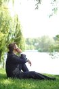 Relaxed businessman talking to his mobile phone Royalty Free Stock Photography