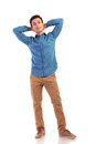 Relaxed casual man with hands behind his head Royalty Free Stock Photo