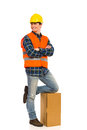 Relaxed construction worker young with arms crossed full length studio shot isolated on white Stock Photos