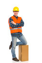 Relaxed construction worker young with arms crossed full length studio shot isolated on white Royalty Free Stock Image