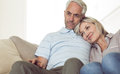 Relaxed couple sitting on sofa Royalty Free Stock Photo