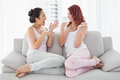 Relaxed female friends chatting in the living room young at home Stock Photo