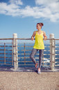 Relaxed fitness woman looking into distance at embankment Royalty Free Stock Photo