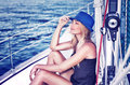 Relaxed girl on sailboat Royalty Free Stock Photo