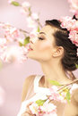 Relaxed girl smelling the spring flowers lady Royalty Free Stock Photo