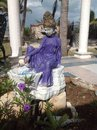 Relaxed goddess fountain purple cement backyard fountain beach Royalty Free Stock Photos