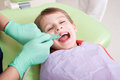 Relaxed kid in dentist chair Royalty Free Stock Photo