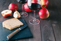 Relaxed lunch with cheese and red wine Royalty Free Stock Photo