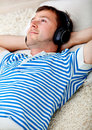Relaxed man listening to music Royalty Free Stock Photo