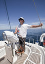 Relaxed man sailing yacht Royalty Free Stock Image