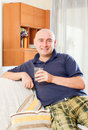 Relaxed man sitting on couch Royalty Free Stock Photo
