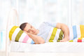 Relaxed man sleeping in a comfortable bed covered with blanket at home Royalty Free Stock Photography