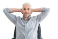Relaxed mature businessman with hands behind head Royalty Free Stock Photo