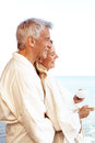 Relaxed mature couple enjoying morning tea Royalty Free Stock Photos