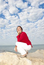 Relaxed mature woman ocean background Royalty Free Stock Image