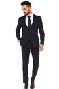 Relaxed modern business man standing with hand in pocket Royalty Free Stock Photo