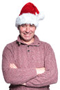 Relaxed old casual man wearing a santa hat is standing with his hands crossed on white background Stock Photography