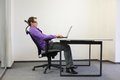 Relaxed position at laptop business man on chair in his office Royalty Free Stock Images