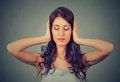 Relaxed woman with eyes closed covering her ears Royalty Free Stock Photo
