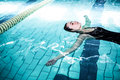 Relaxed woman floating in the swimming pool Royalty Free Stock Photo