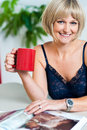 Relaxed woman in lingerie enjoying her beverage Stock Photos