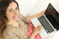 Relaxed woman surfing on her laptop Royalty Free Stock Photo