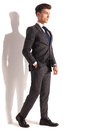 Relaxed young business man walking Royalty Free Stock Photo