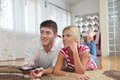 Relaxed young  couple watching tv at home Stock Photos