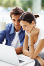 Relaxed young couple working on laptop Royalty Free Stock Photo