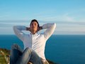 Relaxed young man at home on balcony Royalty Free Stock Photo