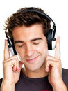 Relaxed young man listening to music on headphone Stock Photo