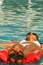 Relaxing on an air mattress Stock Image