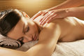 Relaxing back massage at spa beautiful woman receiving a Royalty Free Stock Photo
