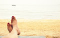 Relaxing on beach with bare feet sea shore Royalty Free Stock Photos