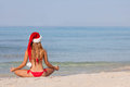 Relaxing beach christmas vacation woman at Stock Photography
