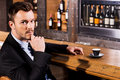 Relaxing with cup of fresh coffee confident young man in formalwear sitting at the bar counter and looking at camera espresso Royalty Free Stock Photo