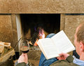 Relaxing by the fire Royalty Free Stock Photos