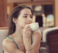 Relaxing girl with cup of coffee looking romantic closeup portrait Royalty Free Stock Photos