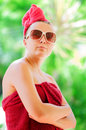 Relaxing glamorous woman in red towel Royalty Free Stock Photography