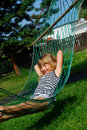 Relaxing in hammock Stock Images