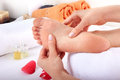 Relaxing healthy foot massage in salon Royalty Free Stock Photo