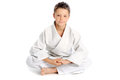 Relaxing karate boy young sitting in lotus pose Stock Images