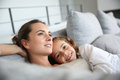 Relaxing moments of mother and her daughter mom little girl in sofa Royalty Free Stock Photos