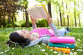 Relaxing in nature with book and music Stock Images