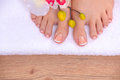 Relaxing pink manicure and pedicure with a orchid flower Royalty Free Stock Photo