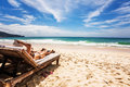 Relaxing and reading on the beach thailand Stock Photos