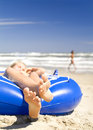 Relaxing in a rubber boat Stock Images