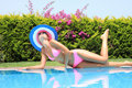 Relaxing by the swimming pool Royalty Free Stock Photos